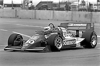 LONG BEACH, CA - APRIL 13: Al Unser, Jr., drives his Lola T86/00/Cosworth enroute to a second place finish in the Toyota Grand Prix of Long Beach CART Indy Car race on the temporary Long Beach Street Circuit in Long Beach, California, on April 13, 1986.