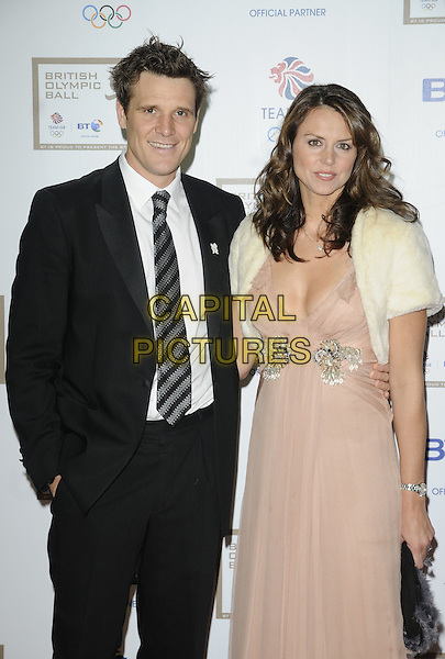 JAMES CRACKNELL & BEVERLEY TURNER .At the British Olympic Ball, Grosvenor House hotel, Park Lane, London, England, 24th September 2010..half length black suit tie  beige nude dress cape shrug cream fur married couple husband wife .CAP/CAN.©Can Nguyen/Capital Pictures.