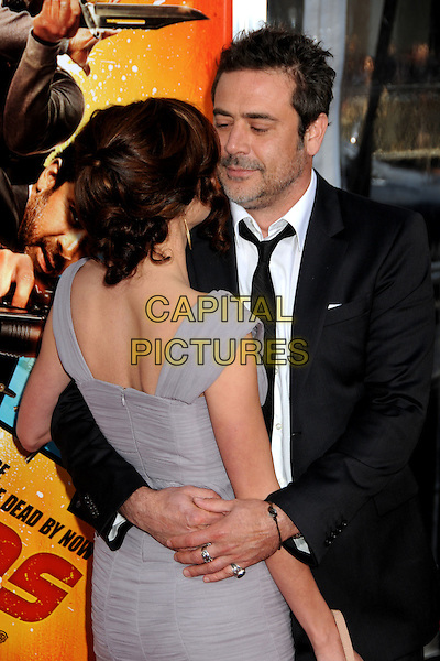 "HILARIE BURTON & JEFFREY DEAN MORGAN .""The Losers"" Los Angeles Premiere held at Grauman's Chinese Theatre, Hollywood, California, USA, .20th April 2010..half length  beard facial hair black  tie white shirt smiling grey gray dress suit back rear behind couple arm arms around hugging hug  .CAP/ADM/BP.©Byron Purvis/AdMedia/Capital Pictures."