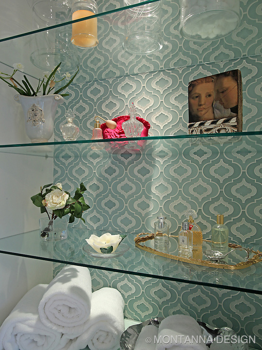 Walker Zanger glass tile creates a beautiful backdrop for her master bath storage and display shelves