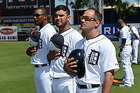 Detroit Tigers Francisco Martinez, Eugenio Suarez, Omar Vizquel during the national anthem before a spring training game against the St. Louis Cardinals on March 3, 2014 at Joker Marchant Stadium in Lakeland, Florida.  Detroit defeated St. Louis 8-5.  (Mike Janes/Four Seam Images)