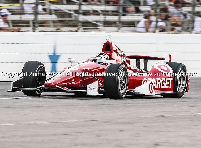Scott Dixon (9) driver of the Target Chip Ganassi Racing car in action during the IZOD Indycar Firestone 550 race at Texas Motor Speedway in Fort Worth,Texas. Justin Wilson (18) driver of the Sonny's BBQ car wins the Firestone 550 race...