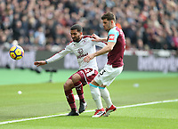 Burnley's Aaron Lennon and West Ham United's Aaron Cresswell<br /> <br /> Photographer Rob Newell/CameraSport<br /> <br /> The Premier League - West Ham United v Burnley - Saturday 10th March 2018 - London Stadium - London<br /> <br /> World Copyright &copy; 2018 CameraSport. All rights reserved. 43 Linden Ave. Countesthorpe. Leicester. England. LE8 5PG - Tel: +44 (0) 116 277 4147 - admin@camerasport.com - www.camerasport.com