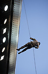 Royal Marines Commandos abseil from the Govan Stand to place the matchball with the referee for kick-off