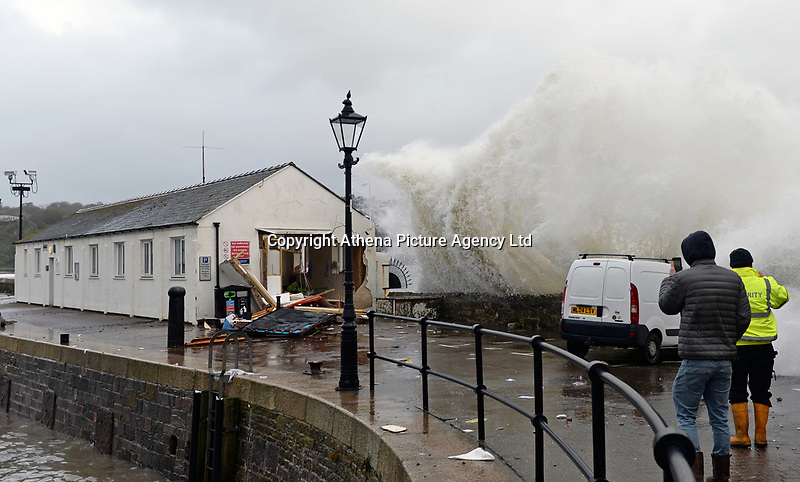 """Pictured: The Harbourmaster's office which has been damaged by waves in Tenby, Wales, UK. Saturday 21 October 2017<br /> Re: Coastal parts of the UK is facing winds of up to 70mph as Storm Brian causes roads to close and public transport to be cancelled.<br /> Roads in Aberystwyth's seafront and at nearby Aberaeron, Wales are shut on Saturday morning as a yellow """"be aware"""" Met Office warning is in place.<br /> Seven flood warnings have been issued for the west Wales coast."""