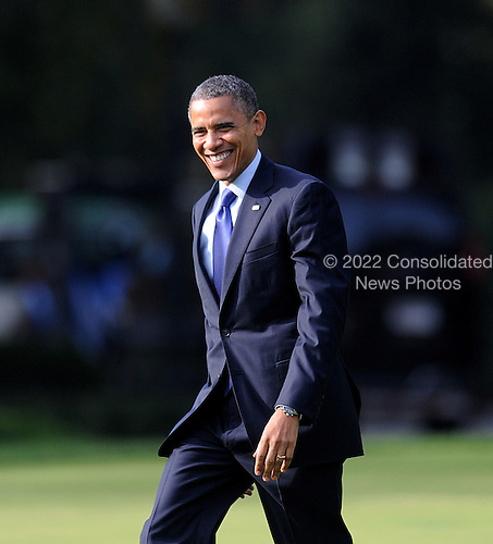 United States President Barack Obama walks toward Marine One as he departs the White House in Washington, D.C.  on October 17, 2012. The President is traveling to Iowa and Ohio to speak at campaign rallies.  .Credit: Olivier Douliery / Pool via CNP