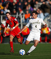 Wake Forest Demon Deacons defender Julian Valentin (4) is chased by Ohio State Buckeyes forward Andrew Magill (10). The Wake Forest Demon Deacons defeated the Ohio State Buckeyes 2-1 in the finals of the NCAA College Cup at SAS Stadium in Cary, NC on December 16, 2007.