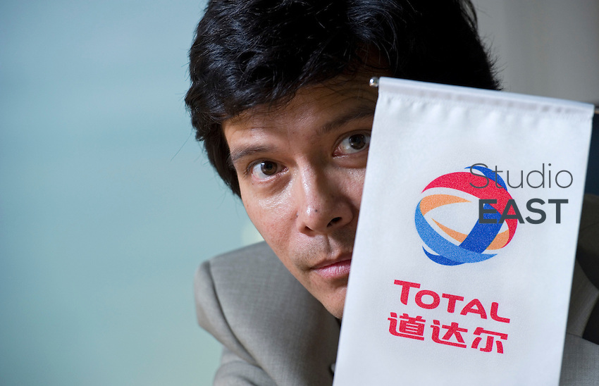 Total International Procurement Office Deputy General Manager Franck Filatriau poses for a photograph with the name 'Total' in Chinese characters, in Total's offices, in Shanghai, China, on September 29, 2010. Photo by Lucas Schifres/Pictobank