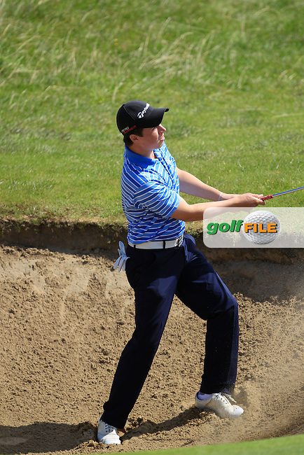 Mark MacGrath (Limerick) chipping from a bunker onto the 16th green during Matchplay Round 3 of the South of Ireland Amateur Open Championship at LaHinch Golf Club on Saturday 25th July 2015.<br /> Picture:  Golffile | TJ Caffrey