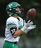 Phil Krpata #32 of Farmingdale fields a kickoff during a Nassau County Conference I varsity football game against host Massapequa High School on Saturday, Sept. 22, 2018. Farmingdale won by a score of 41-27.