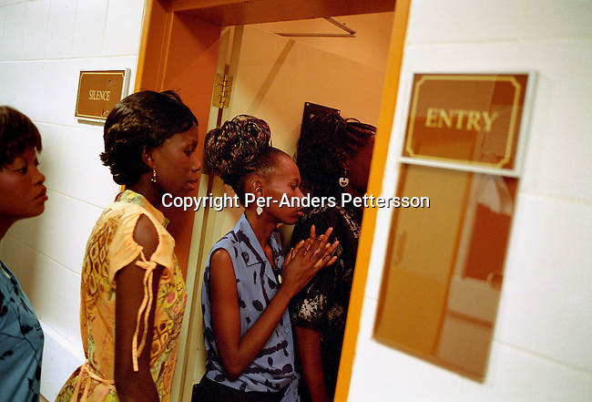 GABORONE, BOTSWANA - FEBRUARY 26: Tracy Busang (L) and Elisabeth Ramolale (R) waits backstage before the Miss HIV Stigma Free Botswana competition held annually in the international convention center on February 26, 2005 in Gaborone, Botswana. The pageant is held to make the people of Botswana more aware of HIV-Aids, and stop the stigma that makes people afraid of being tested. Botswana has a population of about 1,7 million people and about 38 percent are believed to be infected with the virus..(Photo: Per-Anders Pettersson/Getty Images).