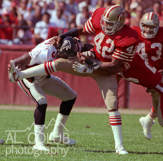 San Francisco 49ers vs Atlanta Falcons at Candlestick Park Sunday, September 23, 1990..49ers beat Falcons 19-13.49er defensive back Ronnie Lott tackles Falcon wide receiver Shawn Collins (85)..
