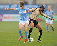 # 8 Megan Rapinoe of the Red Stars battle for the ball against # 9 Kandace Wilson of FC Gold Pride.   FC Gold Pride beat the Red Stars 1-0.