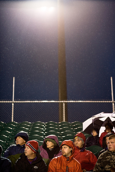 """March 14, 2009. Cary, NC.. The Carolina Railhawks went home in foul weather with a  1-0 victory over the New England Revolution of the MLS, in the inaugural """"Community Shield"""" match and their first professional outing under new coach, Martin Rennie. . Fans braved the rain to see their team to victory."""
