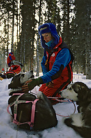 Libby Riddles Checks Dogs @ Rohn Chkpt 1989 Iditarod AK Winter