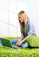 Blonde teenage girl using a laptop computer