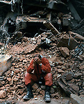 Swedish Rescue worker, crys at the site where a hospital has collapsed. He is eacating to the orders of the Mexican Army that the remaining structure be bulldozed- effectively ending the efforts to rescue many people still known to be alive under the rubble- as a precaution against plague. This is days after an Earthquake (Sept. 19, 1989) did major damage to downtown Mexico City, in September, 1989. Photo by Jim Peppler. Copyright/Jim Peppler/.
