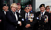 London, UK  20/06/2011. Mayor Boris Johnson with war veterans. With the country about to mark Armed Forces Day (25 June 2011), London Mayor Boris Johnson urged war veterans to sign up for free travel on public transport in the capital during a flag raising ceremony at City Hall.
