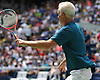 John McEnroe moves toward the net during an exhibition doubles match at the newly-reopened Louis Armstrong Stadium in Corona, NY on Wednesday, Aug. 22, 2018. The 14,000 seat stadium which features a retractable roof will host US Open matches starting Monday, Aug. 27.