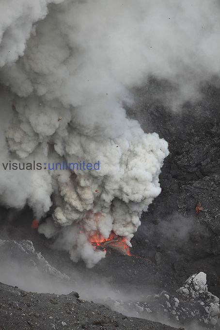Glowing eruptive vent degassing and blowing out volcanic bombs of Dukono Volcano, Halmahera, Indonesia.