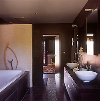 A modern bathroom with two washbasins set on a cupboard unit.