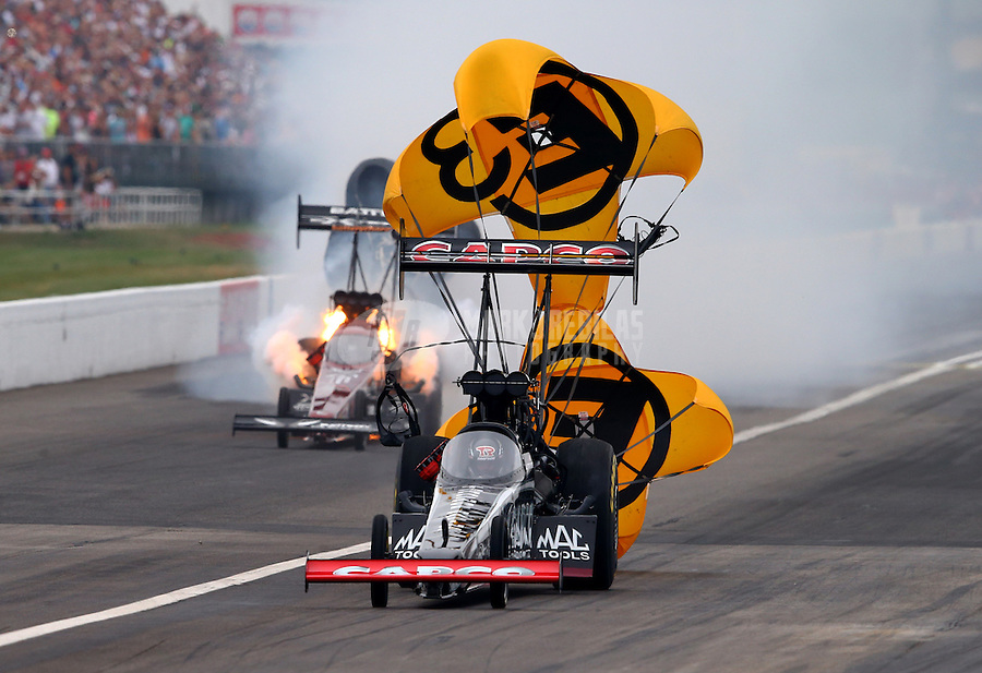 Sept. 2, 2013; Clermont, IN, USA: NHRA top fuel dragster driver Spencer Massey (left) explodes an engine alongside Billy Torrence during the US Nationals at Lucas Oil Raceway. Mandatory Credit: Mark J. Rebilas-