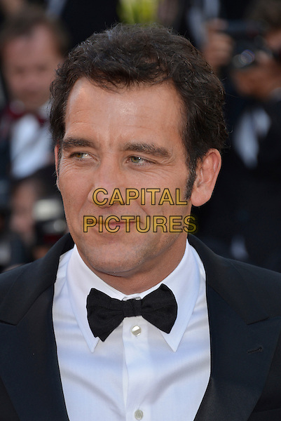 Clive Owen.'Blood Ties' premiere at the 66th  Cannes Film Festival, France..20th May 2013.headshot portrait bow tie shirt white black tuxedo .CAP/PL.©Phil Loftus/Capital Pictures.