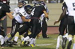 Torrance, CA 09/20/13 - Luke Megginson (Peninsula #78) and David Aros (Torrance #4) in action during the Palos Verdes Peninsula vs Torrance varsity football game at Torrance High School.