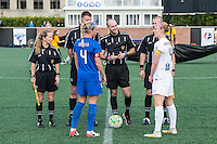Allston, MA - Sunday, May 22, 2016: Game official and Boston Breakers defender Whitney Engen (4) and FC Kansas City defender Becky Sauerbrunn (4) during coin toss prior a regular season National Women's Soccer League (NWSL) match at Jordan Field.