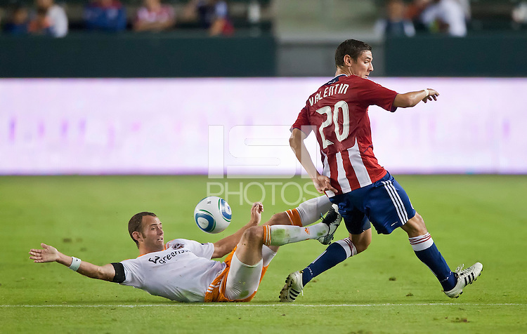 CARSON, CA – July 23, 2011: Houston Dynamo midfielder Brad Davis (11) and Chivas USA defender Zarek Valentin (20) during the match between Chivas USA and Houston Dynamo at the Home Depot Center in Carson, California. Final score Chivas USA 3, Houston Dynamo 0.