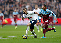 23rd November 2019; London Stadium, London, England; English Premier League Football, West Ham United versus Tottenham Hotspur; Harry Winks of Tottenham Hotspur charges past Sebastien Haller of West Ham United  - Strictly Editorial Use Only. No use with unauthorized audio, video, data, fixture lists, club/league logos or 'live' services. Online in-match use limited to 120 images, no video emulation. No use in betting, games or single club/league/player publications