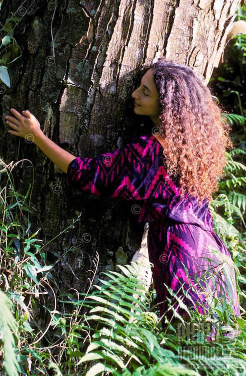 Woman hugging a tree, Kapoho crater, Puna, Hawaii
