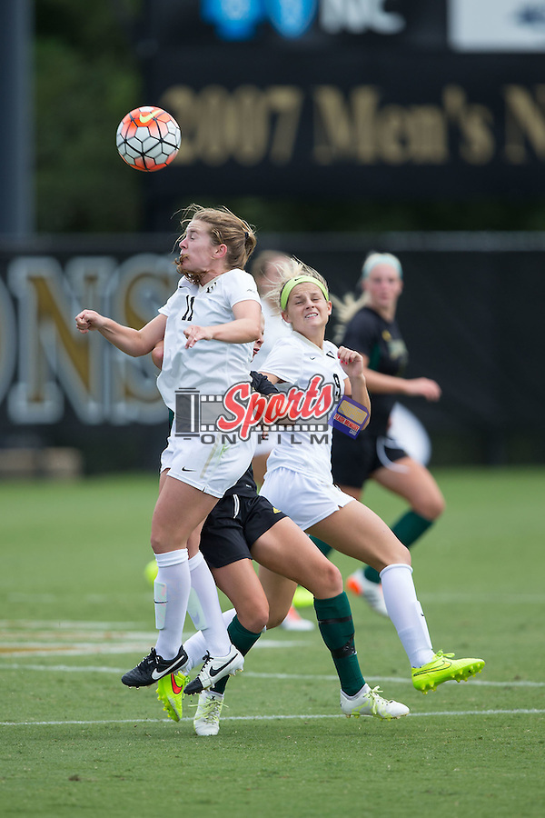 Maddie Huster (11) of the Wake Forest Demon Deacons heads the ball during second half action against the George Mason Patriots at Spry Soccer Stadium on September 13, 2015 in Winston-Salem, North Carolina.  The Demon Deacons defeated the Patriots 1-0.  (Brian Westerholt/Sports On Film)