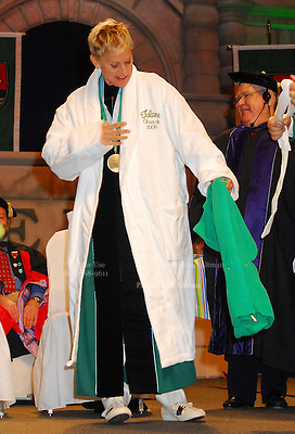 New Orleans native and Emmy winning televison host Ellen DeGeneres stands in her new Tulane Class of 2009 University bathrobe holding her mothers sweater that was returned by Tulane Univ. President many years after Ellens mom worked their during Tulane University graduation exercises at the Louisiana Superdome in New Orleans, Saturday, May 16, 2009. Ellen gave the commencment speech to the Katrina Class also know as the graduating clas of 2009.( Photo © Suzi Altman)