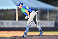 Lexington Legends starting pitcher Charlie Neuweiler (31) looks in for the signals during a game against the Asheville Tourists at McCormick Field on July 1, 2019 in Asheville, North Carolina. The Tourists defeated the Legends 9-8. (Tony Farlow/Four Seam Images)