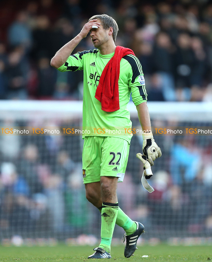 Jussi Jaaskelainen of West Ham holds his head at the end of the game - West Ham United vs West Bromwich Albion, Barclays Premier League at Upton Park, West Ham - 28/12/13 - MANDATORY CREDIT: Rob Newell/TGSPHOTO - Self billing applies where appropriate - 0845 094 6026 - contact@tgsphoto.co.uk - NO UNPAID USE