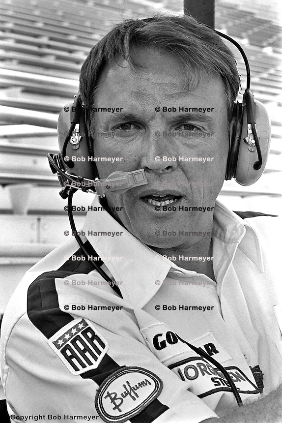 INDIANAPOLIS, IN: Dan Gurney monitors cornering speeds from an observer's stand in Turn 4 during practice for the Indianapolis 500 on May 19, 1977, at the Indianapolis Motor Speedway.