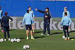 Atletico's players listen to Mono Burgos during a training session the day before quarterfinal first leg Champions League soccer match against Real Madrid at Vicente Calderon stadium in Madrid, Spain. April 13, 2015. (ALTERPHOTOS/Victor Blanco)
