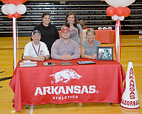 Graham Thomas/Siloam Sunday<br /> Siloam Springs senior Matthew Avery signed a letter of intent Wednesday to join the cheerleading team at the University of Arkansas. Pictured are: Front from left, father Steve Avery, Matthew Avery, mother Mickey Avery; back, Elicia Williamson and SSHS cheer coach Jackie Clement.