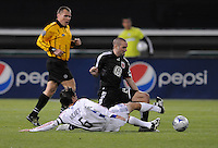 DC United midfielder Brandon  Barklage (24) gets tackled by FC Dallas midfielder Pablo Ricchetti (6).  DC United defeated FC. Dallas 2-0 in the first home game of the US Open Cup title at RFK Stadium, Wednesday April 22, 2009.