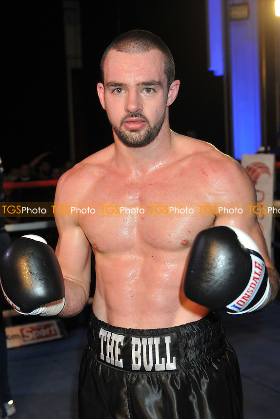 Chris Baugh (black shorts) defeats Harj Gill - Boxing at the Camden Centre, London - 28/11/14 - MANDATORY CREDIT: Philip Sharkey/TGSPHOTO - Self billing applies where appropriate - contact@tgsphoto.co.uk - NO UNPAID USE