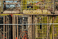 Lobster traps being taken in at the close of the season, Cape Cod, Massachusetts, USA