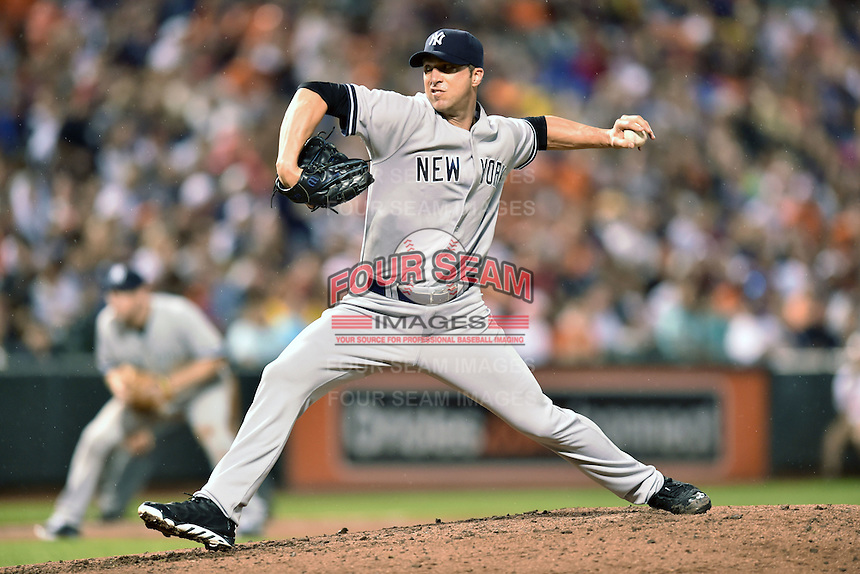 New York Yankees starting pitcher Chris Capuano #26 delivers a pitch during a game against the Baltimore Orioles at Oriole Park at Camden Yards August 11, 2014 in Baltimore, Maryland. The Orioles defeated the Yankees 11-3. (Tony Farlow/Four Seam Images)
