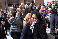 State Representative Michelle DuBois (D-10th Plymouth District) (center left) and Rosa Nicholas, 65, of Brockton, Mass., embrace after a rally in support of immigrants' rights outside Brockton City Hall after rumors of an Immigration and Customs Enforcement (ICE) raid traveled around the community in Brockton, Massachusetts, USA. The rally was organized in part by the Coalition for Social Justice. Rumors of the ICE raid went viral within the community after DuBois posted a warning about the supposed raid on Facebook and that undocumented immigrants should not go outside. Nicholas is a naturalized citizen originally from Cape Verde and has lived in the area for about 40 years. She said she came to rally to show her support for the local immigrant community.