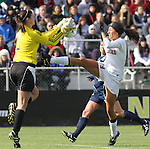 05 December 2010: Notre Dame's Nikki Weiss (1) grabs the ball off of the foot of Stanford's Christen Press (23)., The Stanford University Cardinal played the Notre Dame University Fighting Irish at WakeMed Stadium in Cary, North Carolina in the 2010 NCAA Women's College Cup Championship Game.