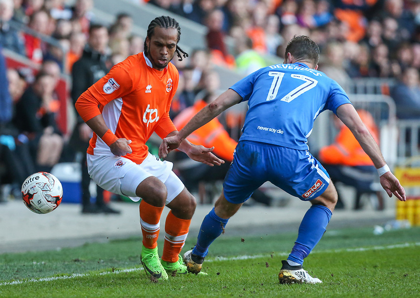 Blackpool's Nathan Delfouneso takes on Hartlepool United's Nicky Deverdics<br /> <br /> Photographer Alex Dodd/CameraSport<br /> <br /> The EFL Sky Bet League Two - Blackpool v Hartlepool United - Saturday 25th March 2017 - Bloomfield Road - Blackpool<br /> <br /> World Copyright &copy; 2017 CameraSport. All rights reserved. 43 Linden Ave. Countesthorpe. Leicester. England. LE8 5PG - Tel: +44 (0) 116 277 4147 - admin@camerasport.com - www.camerasport.com