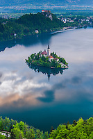 Lake Bled Island and Bled Castle at sunrise, Julian Alps, Gorenjska, Slovenia, Europe
