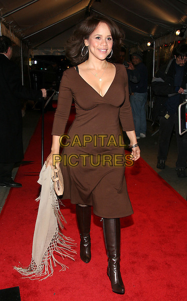 "ROSIE PEREZ.""Syriana"" world premiere at Lowes Lincoln Square Theatre, New York, NY.  .November 20th, 2005.Photo: Jackson Lee/Admedia/Capital Pictures.Ref: JL/ADM.full length brown dress boots plunging neckline cleavage.www.capitalpictures.com.sales@capitalpictures.com.© Capital Pictures."