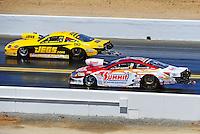 Jul. 18, 2010; Sonoma, CA, USA; NHRA pro stock driver Jeg Coughlin Jr (left) defeats Greg Anderson during the Fram Autolite Nationals at Infineon Raceway. Mandatory Credit: Mark J. Rebilas-