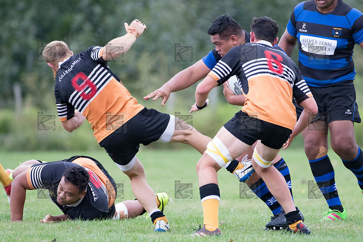 Caleb Brown gets unceremoniously shunted out of the way by Abraham Falani. Counties Manukau Premier Counties Power Club Rugby Round 2, Game of the Week, between Te Kauwhata and Onewhero, played at Te Kauwhata on Saturday March 17th 2018. <br /> Photo by Richard Spranger.<br /> <br /> Onewhero won the game 43 - 10 after leading 21 - 10 at halftime.<br /> Te Kauwhata EnviroWaste  10 - Lani Latu try,  Caleb Brown 1 conversion, Caleb Brown 1 penalty.<br /> Onewhero 43 - Jackson Orr 2, Ilaisa Koaneti 2, Vaughan Holdt, Zac Wootten, Rhain Strang tries, Vaughan Holdt 4 conversions.
